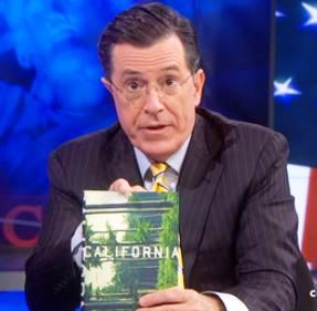 Stephen Colbert displays the book California by Edan Lepucki